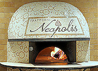 Custom mosaic retail signs - Trattoria Neapolis pizza oven in Tavertine White, Saint Laurent, Travertine Noce, Giallo, and Rojo Alicante.  Located in Pasadena, California.