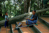 Land mine victim at the stairs Phnom Kulen, Cambodia