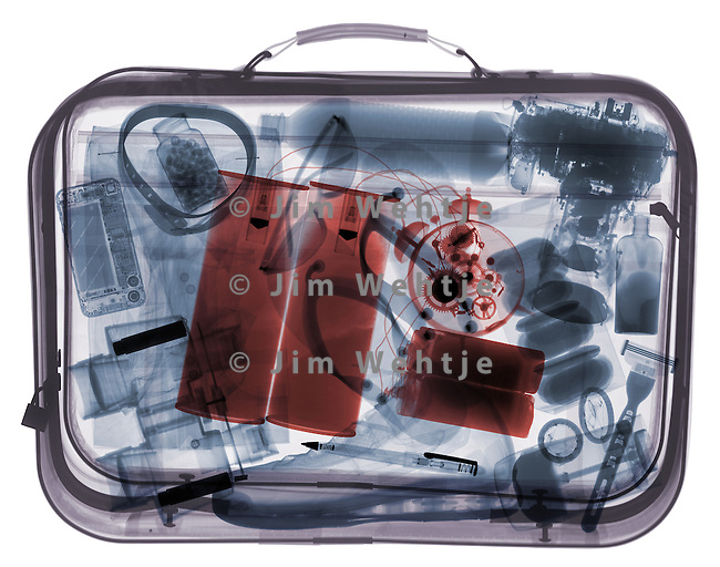 X-ray image of a full suitcase with bomb (color on white) by Jim Wehtje, specialist in x-ray art and design images.