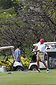 Kailua, Hawaii - December 29, 2008 -- United States President-elect Barack Obama tees off on the tenth hole as he plays golf with friends in Kailua, Hawaii on Monday, December 29, 2008. Obama and his family arrived in his native Hawaii December 20 for the Christmas holiday..Credit: Joaquin Siopack - Pool via CNP