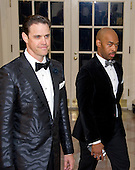 Author Robert Anderson, left, and Eric Harland, right, arrive for the State Dinner in honor of Prime Minister Trudeau and Mrs. Sophie Gr&eacute;goire Trudeau of Canada at the White House in Washington, DC on Thursday, March 10, 2016.<br /> Credit: Ron Sachs / Pool via CNP