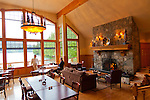 Eagle Nook Wilderness Resort and Spa is located on a remote area of Vancouver Island.   The dining room offers views of the bay and a warm fireplace.