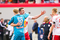 Kenny Cooper (33) of the New York Red Bulls\ celebrates with goalkeeper Ryan Meara (18) and Markus Holgersson (5) after defeating the New England Revolution . The New York Red Bulls defeated the New England Revolution 1-0 during a Major League Soccer (MLS) match at Red Bull Arena in Harrison, NJ, on April 28, 2012.