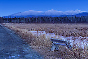 Snow-capped Northern Presidential Range just after sunset from along the Presidential Range Rail Trail (Cohos Trail) at Pondicherry Wildlife Refuge in Jefferson, New Hampshire USA during the winter months.