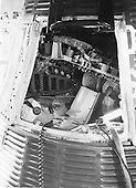 Astronaut John H. Glenn Jr., backup astronaut for MR-4, inspects the interior of a Mercury Spacecraft on Pad 5 in July, 1961. He is reviewing material on the checklist he is holding against the consoles in front of him..Credit: NASA via CNP