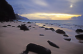 The pristine natural beauty of the Na Pali shoreline at sunset on the island of Kauai.