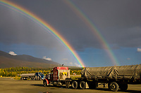Rainbow over the Brooks range mountains viewed from the Coldfoot truck stop parking lot, arctic, Alaska.