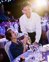 Acting Minister Chan Chun Sing hands out award at MCYS Volunteer Awards 2012