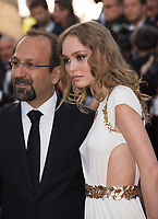 Lily-Rose Depp &amp; Asghar Farhadi at the premiere for &quot;Ismael's Ghosts&quot; at the opening ceremony of the 70th Festival de Cannes, Cannes, France. 17 May 2017<br /> Picture: Paul Smith/Featureflash/SilverHub 0208 004 5359 sales@silverhubmedia.com