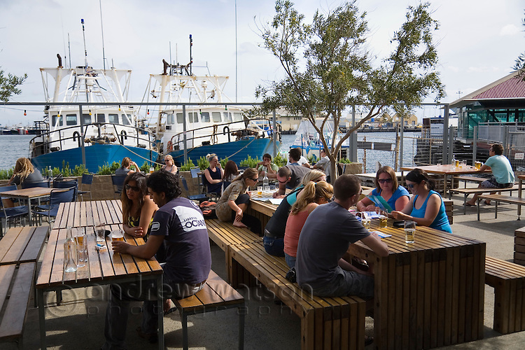 Beer garden at the Little Creatures Brewery on Fishing Boat Harbour.  Fremantle, Western Australia, AUSTRALIA.