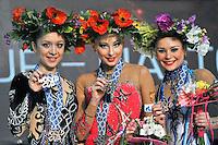 "(L-R) SILVIYA MITEVA of Bulgaria (silver), DARIA KONDAKOVA of Russia (gold), ULYANA TROFIMOVA of Uzbekistan (bronze) celebrate winning ball Event Final medals at 2011 World Cup Kiev, ""Deriugina Cup"" in Kiev, Ukraine on May 8, 2011."