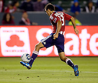 Chivas USA defender Jonathan Bornstein (13) moves outside with the ball. CD Chivas USA defeated the San Jose Earthquakes 3-2 at Home Depot Center stadium in Carson, California on Saturday April 24, 2010.  .