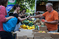 Farmers and shoppers at Dufferin Grove Organic Farmers Market in Toronto.