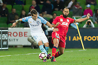 Melbourne, 28 October 2016 - FERNANDO BRANDAN (27) of Melbourne City and TAREK ELRICH (21) of Adelaide compete for the ball in the round 4 match of the A-League between Melbourne City and Adelaide United at AAMI Park, Melbourne, Australia. Melbourne won 2-1 (Photo Sydney Low / sydlow.com)