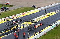 May 22, 2016; Topeka, KS, USA; NHRA top fuel driver Doug Kalitta (right) races alongside Steve Torrence during the Kansas Nationals at Heartland Park Topeka. Mandatory Credit: Mark J. Rebilas-USA TODAY Sports