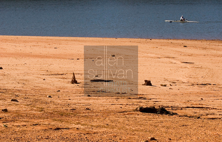 A kayaker moves past an exposed section of lake bed on Lake Lanier. The lake provides water for parts of Georgia, Alabama and Florida.