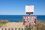 Erosion at Cape Cod National Seashore warning sign on cliff at Nauset Light Beach, Eastham