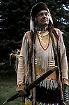 Half length portrait of Native American dressed regalia for the Hunter Mountain pow wow in New York State.
