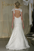 Model walks runway in a Sugar Berry wedding dress by Carol Hannah Whitfield, for the Carol Hannah Spring Summer 2012 Bridal collection runway show.