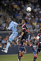 Kei Kamara (23) forward Sporting KC goes up for a header with Shalrie Joseph (21) midfield New England Revolution..Sporting Kansas City and New England Revolution played to a 0-0 tie at LIVESTRONG Sporting Park, Kansas City, KS.
