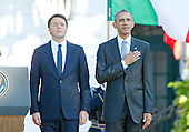 United States President Barack Obama, right, and Prime Minister Matteo Renzi of Italy, left, listen to their nation's National Anthems during an Official Arrival Ceremony in the Prime Minister's honor on the South Lawn of the the White House in Washington, DC on Tuesday, October 18, 2016. <br /> Credit: Ron Sachs / CNP
