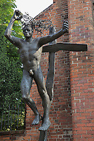 Sculpture of Christ with his crown of thorns on the cross in front of the ruins of the Franziskaner-Klosterkirche or Franciscan Monastery Church, c. 1250, destroyed during World War Two, on Waisenstrasse, Mitte, Berlin, Germany. Picture by Manuel Cohen