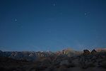 California, east central, Lone Pine. Rock formations in the Alabama Hills recreation area with stars over the Sierra Nevada Mountains.