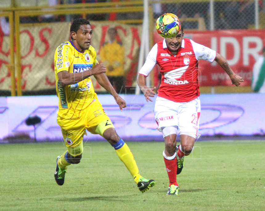 BOGOTA -COLOMBIA- 26 -10--2013. Silvio Gonzalez(Der)  de Independiente Santa Fe disputa el balon contra Wilson Galeano (Izq) del Deportivo Pasto, encuentro de la fecha dieciseisava de la  Liga Postobon segundo semestre jugado en el estadio de Techo  / Silvio Gonzalez (R) of Independiente Santa Fe dispute the ball against Wilson Galeano  (L) of Deportivo Pasto, date sixteenth meeting of the Postobon  League second half played in the stadium Techo .Photo: VizzorImage / Felipe Caicedol / Staff