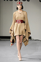 Model walks runway in an outfit from the Nedret Taciroglu Fall 2012 collection, during Couture Fashion Week New York Fall 2012.