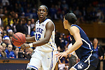 17 December 2013: Duke's Chelsea Gray (12) and UConn's Bria Hartley (right). The Duke University Blue Devils played the University of Connecticut Huskies at Cameron Indoor Stadium in Durham, North Carolina in a 2013-14 NCAA Division I Women's Basketball game. UConn won the game 83-61.