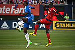 Chelsea FC player Lukaku Romelu (L) fights for the ball with Paris Saint-German FC player Sakho Mamadou during their soccer match at the Yankee Stadium in New York, July 22, 2012. Photo by Eduardo Munoz Alvarez / VIEW.