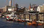 Barges against  Hamburg skyline, Hamburg, Germany.