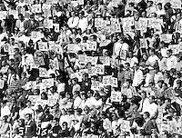 Charter Day at University of California at Berkeley 1966 . Students at the Greek Theater holding signs protesting the Viet Nam War. .(photo copyright 1966 Ron Riesterer/Oakland Tribune)