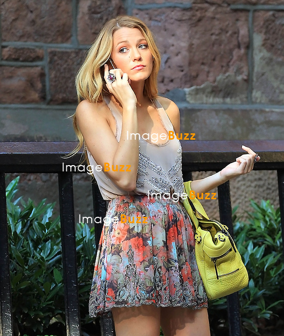 "Blake Lively chatting with friend on her cell phone while filming "" Gossip Girl "" in New York City..New York, August 3, 2012."