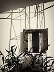 Cypriot house with shadows on wall in the evening