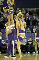 December 29, 2013:  Washington cheerleader Hannah Tripp entertained fans during the game against Hartford.  Washington defeated Hartford 73-67 at Alaska Airlines Arena in Seattle, Washington.