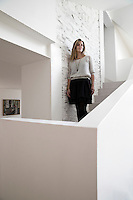 Owner Annabel Gueret on the staircase of her home in a converted tannery