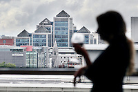7/9/2010. Convention Centre opens. A lady has a glass of wine while looking at the view of the city  at the official opening of the Dublin Convention Centre. Picture James Horan/Collins