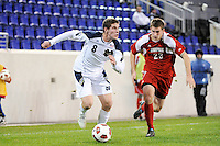 Dillon Powers (8) of the Notre Dame Fighting Irish is chased by J.T. Murray (23) of the Louisville Cardinals. The Louisville Cardinals defeated the Notre Dame Fighting Irish 1-0 during the semi-finals of the Big East Men's Soccer Championship at Red Bull Arena in Harrison, NJ, on November 12, 2010.