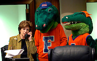 TALLAHASSEE, FL. 4/11/07-Sen. Nan Rich, R-Weston, talks on the phone with her office as Albert and Alberta, mascots of the University of Florida, lurk in the background during University of Florida Day, Wednesday at the Capitol in Tallahassee. COLIN HACKLEY PHOTO