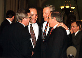 United States Senators share a light moment in the U.S. Capitol in Washington, D.C. following the U.S. Senate vote acquitting U.S. President Bill Clinton on February 12, 1999.  From left to right: U.S. Senator Dick Durbin (Democrat of Illinois); U.S. Senator Charles Schumer (Democrat of New York); U.S. Senator Orrin Hatch (Republican of Utah); and U.S. Senator Robert Torricelli (Democrat of New Jersey)..Credit: Ron Sachs / CNP