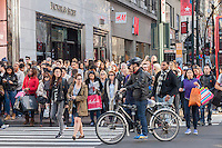 Hordes of shoppers laden with their purchases crossHerald Square in New York on the day after Thanksgiving, Black Friday, November 27, 2015. The National Retail Federation estimates that 135.8 million American will shop in person and online during the four day Thanksgiving weekend.  (© Richard B. Levine)