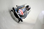15 December 2007: USA 1 pilot Shauna Rohbock, with Valerie Fleming on the brakes, exit turn 19 during their first run of the FIBT World Cup Bobsled Competition at the Olympic Sports Complex on Mount Van Hoevenberg, at Lake Placid, New York, USA. .Mandatory Photo Credit: Ed Wolfstein Photo