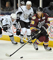Chicago Wolves' Brent Regner takes control of the puck during the second period of an AHL hockey against the Chicago Wolves, Friday, Oct. 4, 2013, in San Antonio. Chicago won 2-1. (Darren Abate/M3D14.com)