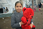 A girl holds a stuffed bear inside a refugee processing center in the Serbian village of Presevo, not far from the Macedonian border. Hundreds of thousands of refugees and migrants--including many children--have flowed through Serbia in 2015, on their way from Syria, Iraq and other countries to western Europe.