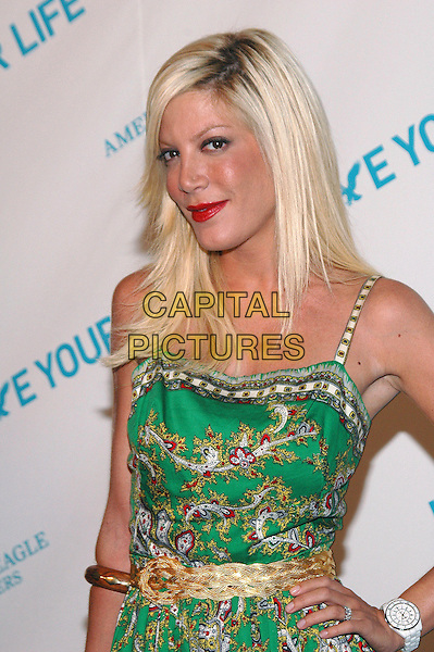 """TORI SPELLING.American Eagle Outfitters' """"Live Your Life Contest"""" winners at the Union Square flagship store in Manhattan, New York, New York..July 27th, 2005  .Photo Credit: Patti Ouderkirk/AdMedia.half length green pattern print dress gold belt hand  wooden bracelet white watch.www.capitalpictures.com.sales@capitalpictures.com.© Capital Pictures."""