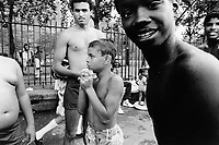 USA. New York City. Spanish Harlem. Carlos (C) and his friends at the open-air swimming pool. Carlos and his Puerto Rican family lives below the poverty line and receives public assistance (AFDC, Home Relief, Supplemental Security Income and Medicaid). Spanish Harlem, also known as El Barrio and East Harlem, is a low income neighborhood in Harlem area. Spanish Harlem is one of the largest predominantly Latino communities in New York City. 20.07.86 © 1986 Didier Ruef ..