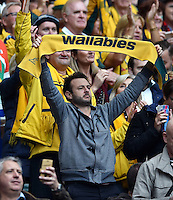 An Australia fan in the crowd holds up a scarf in support. Rugby World Cup Quarter Final between Australia and Scotland on October 18, 2015 at Twickenham Stadium in London, England. Photo by: Patrick Khachfe / Onside Images