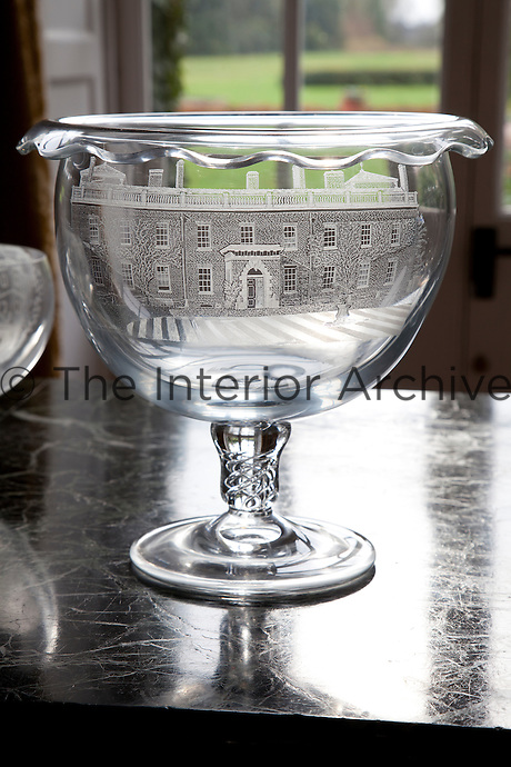 A large glass etched with an image of Euston Hall stands on display in the dining room