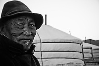 A herdsman in rural Mongolia. We shared several shots of vodka with him on the porch of our ger when he herded his flock through our camp before riding off into the sunset.